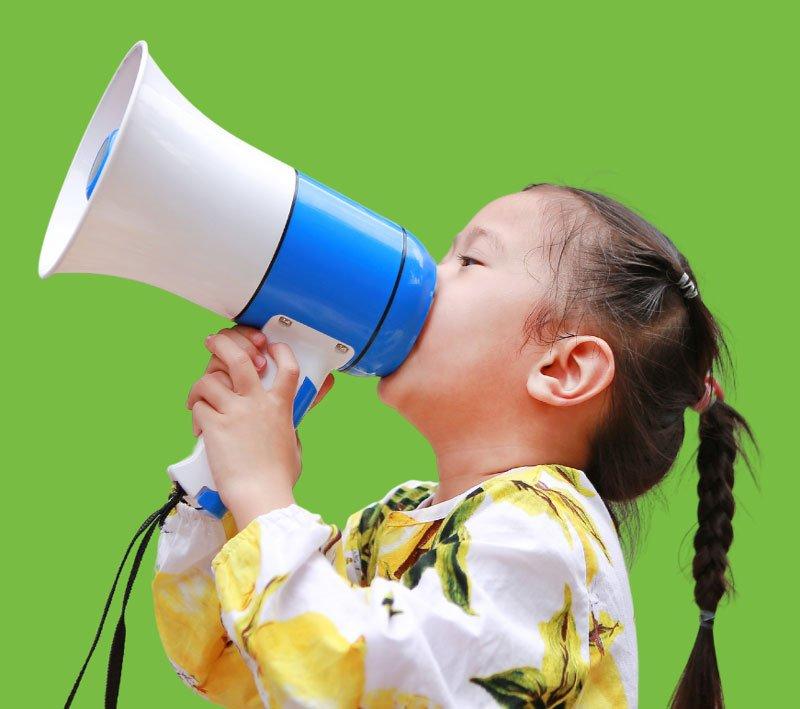 Little Girl speaking into megaphone